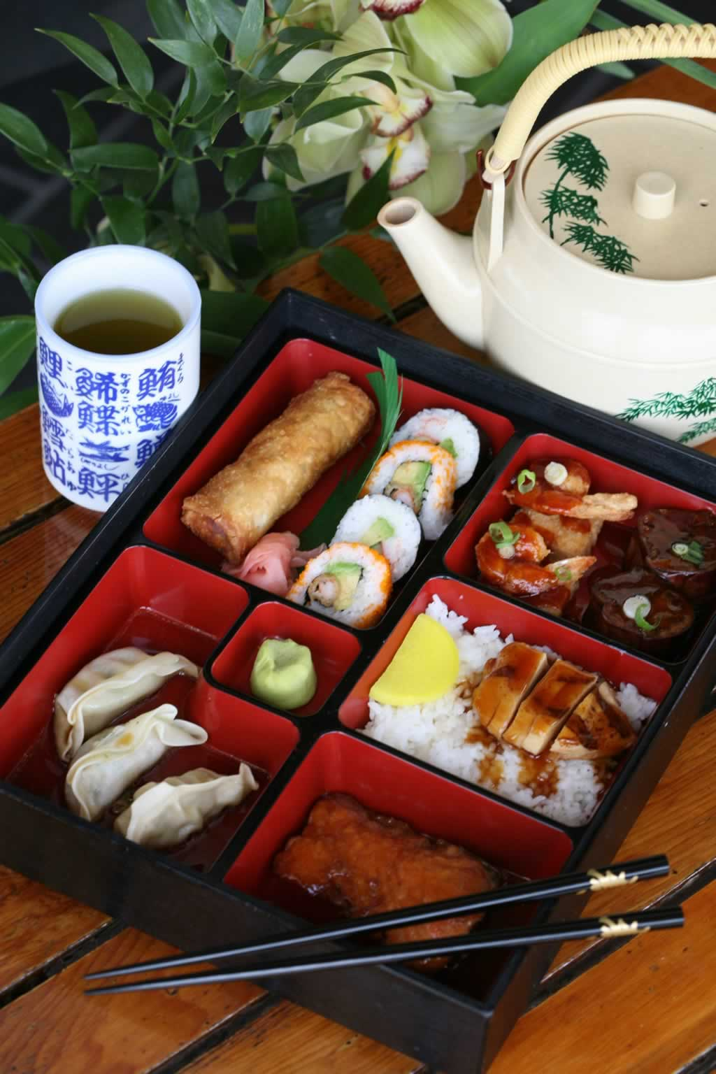 A bento box lunch with hot green tea, served at the Cornell Cafe