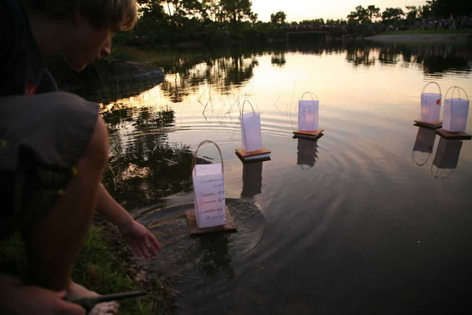 Lanterns drift out over Lake Morikami
