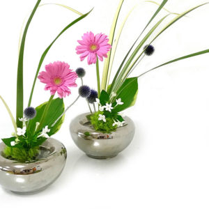 Pink flowers in metal vases