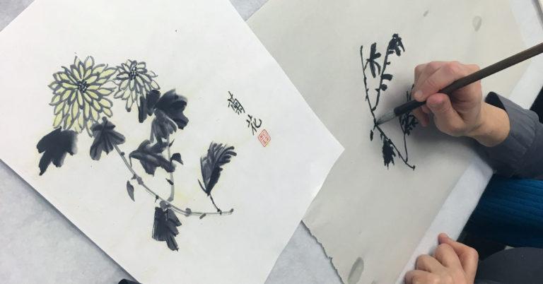 Hand using sumi-e brush